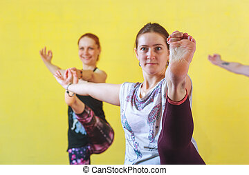 Group of middle aged women practicing yoga