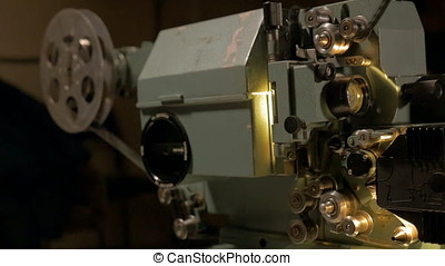 Old mechanical movie projector working