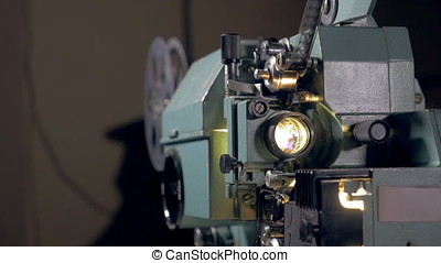 Old mechanical film projector working - Old film projector...