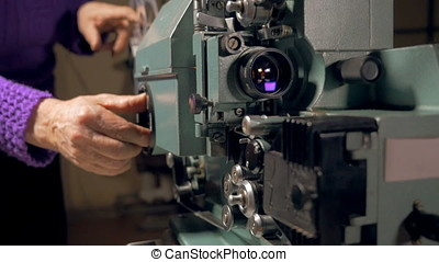 Old-fashioned movie projector in operation - Old-fashioned...