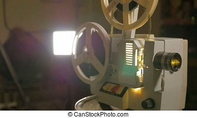 Old film projector in operation - Old film projector...