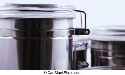 Containers for tea and coffee - Capacities with a closing...
