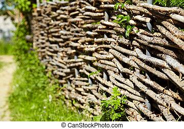 wicker rustic fence in the garden - wicker rustic fence in...