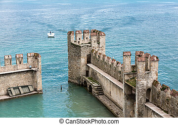 Medieval castle Scaliger in old town Sirmione on lake Lago...