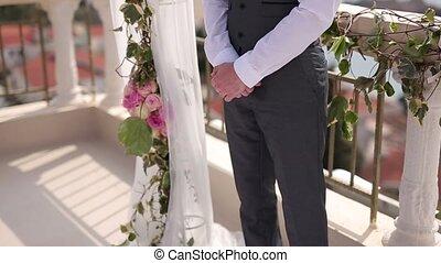 Man's hands. He crossed his fingers. Wedding in Montenegro.