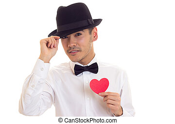 Young man holding a read heart - Young confident man with...