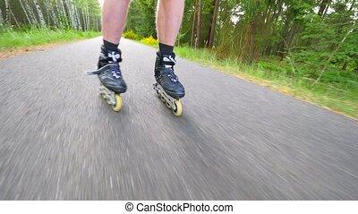 Backwards inline skating and braking on the asphalt. Close...