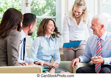 Business women and men in office having presentation -...