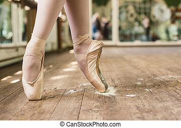 Pointe Shoes In Rosin - Ballerina standing on toes. Closeup...