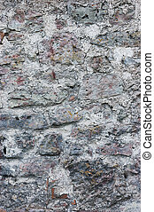 Stone wall background closeup, vertical plastered grunge red grey beige stonewall limestone pattern, old aged weathered gray lime plaster texture, natural grungy textured reddish vintage rough rustic bricks birckwork