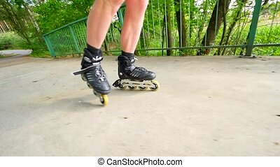 Front close view to inline skates riding on the bridge ....