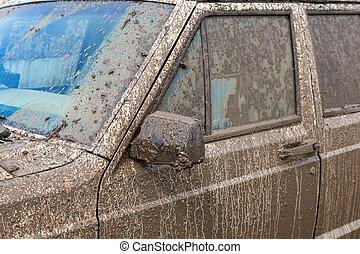 Dirty SUV after driving in the rain on extremely dirty rural...