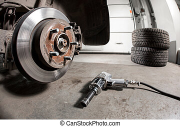 Closeup disc brake of the vehicle for repair. shot wheel,...