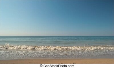 Seascape at daytime. - Sea and cloudless sky. Blue water and...