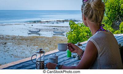 Women with Coffee Cup near Seaweed Algal Plantations - Nusa...