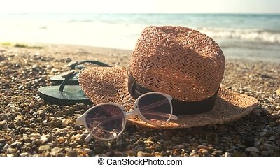 Hat and sunglasses, shore. Flip flops and sunlight. The...