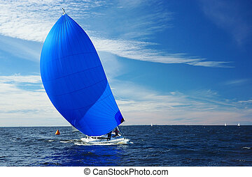 Yacht with blu spinnaker - Sailing yacht race. Yachting....