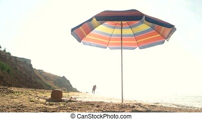 Umbrella on the shore. Beach and sky. Discover your own...