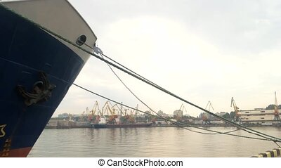 Ship nose and anchor. Vessel moored at the port. Marine...