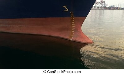 Ship nose on port background. Anchor and ropes. Maritime...