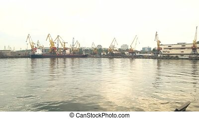 Port with cranes. Tanker at the harbor, daytime. Marine...