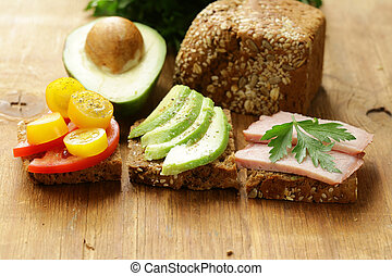 Sandwich with rye bread, avocado and tomatoes