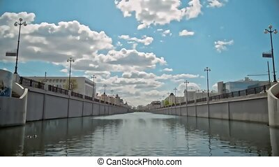 Summer clouds over city Canal, stylized time-lapse. Flying...