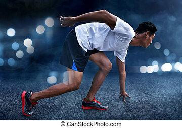 Asian man ready to run