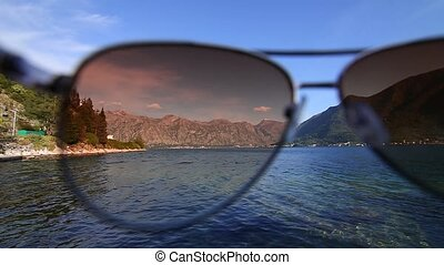 Bay of Kotor, wears glasses at the camera.