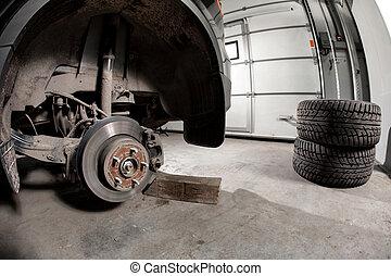 Closeup disc brake of the vehicle for repair. - Closeup disc...