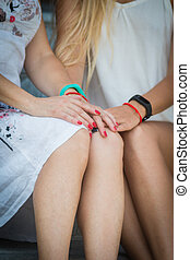 happy senior mother and adult daughter hold hands, close-up