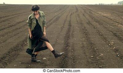 Stylish woman walking on ground of field - Woman wearing...