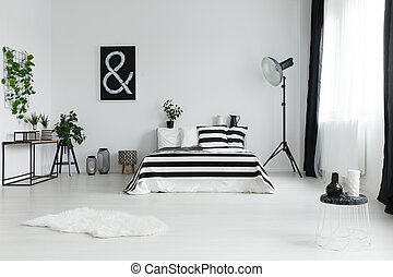 Bedroom with rug and decorations