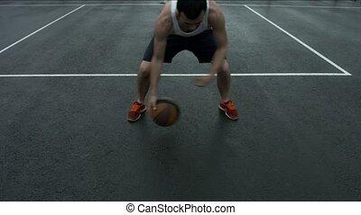 Freestyle basketball ball on street Playground.