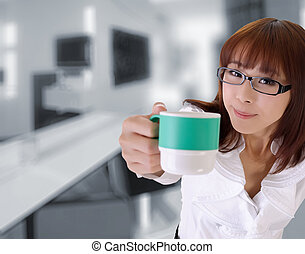 Cute business woman give you a cup of coffee in office