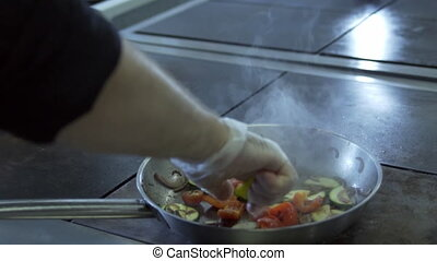 Flaming stir fry slow motion - vegetables are fried in a pan