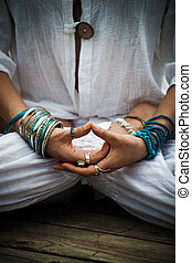 woman in a meditative yoga position lower body - woman in a...