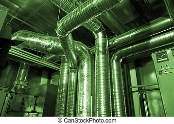 Ventilation pipes of an air condition in green tones...