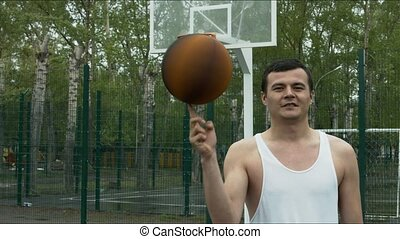 The guy spinning a basketball on his finger on the open area