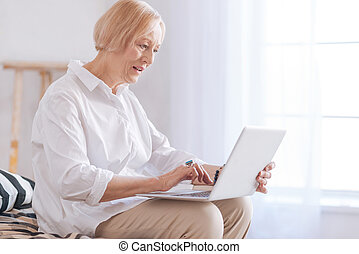 Enigmatical aged lady using her computer - I am shocked....