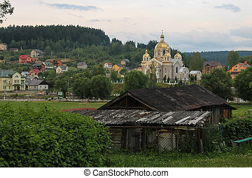 Panorama of Schodnica on slope of forested mountains....
