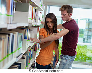 couple breaking up in library - two caucasian students...