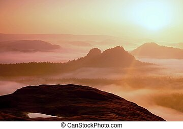 Dreamy misty landscape. Majestic mountain cut the lighting...