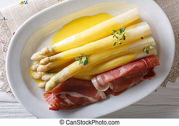 Delicious fresh white asparagus with hollandaise sauce and...
