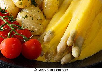 Vitamin food: asparagus with hollandaise sauce, new...
