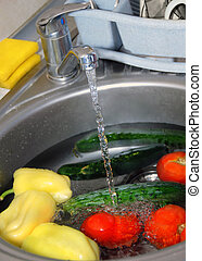 Washing vegetables - washing tomatoes, cucumbers and paprika...