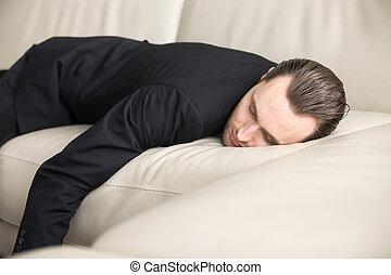 Tired businessman takes break for short sleep - Tired...