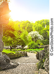 Walking gravel paths in Humble Administrator's Garden in...