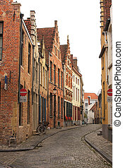 Street with historic medieval buildings, Bruges, Belgium -...