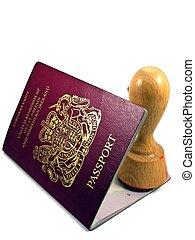 British passport & rubber stamp - A British passport with a...